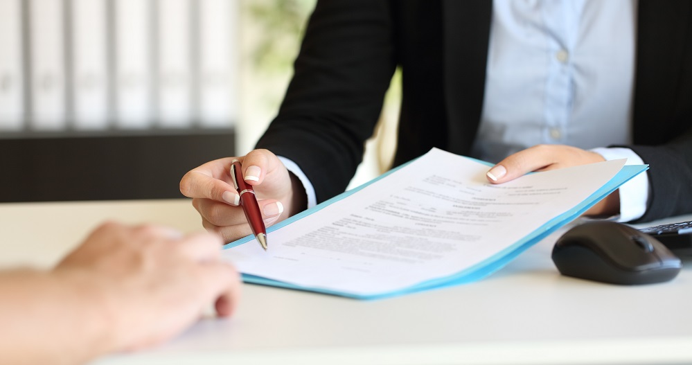 Landlord and Tenant signing documents